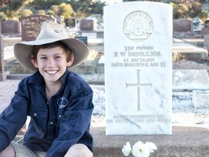 Charlie (Great great grandnephew) at Walter's grave. Anzac Day 2016 - Orroroo Cemetery.